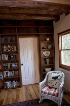 main sitting area NW corner - bookshelves and rocker