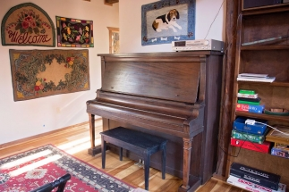 main sitting area SW corner - piano and fabric arts